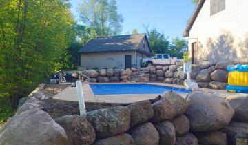 Boulder Wall Around Pool in Andover