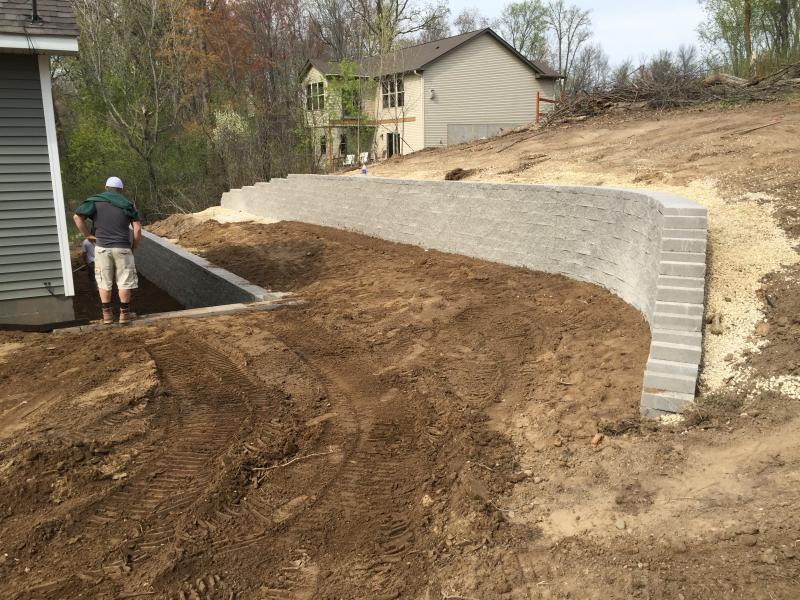 Retaining walls boulder walls black dirt delivery ham for Best backfill material for foundation